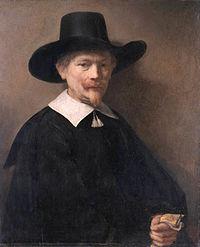 A Man holding Gloves, by Rembrandt van Rijn.jpg