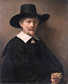 A Man holding Gloves, by Rembrandt van Rijn.jpg