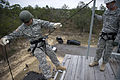 A U.S. Soldier with the 7th Special Forces Group (Airborne), starts to rappel down a 40-foot training tower during rappel training at Eglin Base Air Force Base, Fla 130204-A-YI554-332.jpg