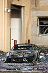 A burned out vehicle sits in the parking lot near the Pentagon Building hours after the September 11, 2001 attacks 010911-N-AV833-016.jpg