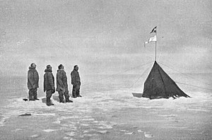 Roald Amundsen - Roald Amundsen and his crew looking at the Norwegian flag at the South Pole, 1911