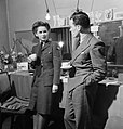 Actress Muriel Pavlow chats with casting director Bob Lennard of the Associated British Picture Corporation in her dressing room at the Globe Theatre, London during 1945. D24344.jpg