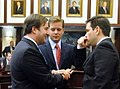 Adam Hasner conferring with Republican colleagues on the House floor.jpg