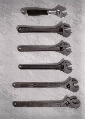 Adjustable spanner - From the bottom: 1. The first adjustable wrench from 1892 (Enköping Mekaniska Verkstad) 2. Adjustable wrench from 1910 with an improved handle (BAHCO) 3. Adjustable wrench from 1915 with a slightly rounder handle (BAHCO) 4. Adjustable wrench from 1954 with improved handle and new jaw angle of 15 degrees (BAHCO) 5. Adjustable wrench from 1984 and the first with ERGO handle (BAHCO) 6. Today's version of the adjustable wrench from 1992 with ERGO (BAHCO)