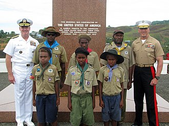 Solomon Islands branch of The Scout Association - Solomon Islands' Scouts posing for a photo with Adm. Patrick M. Walsh and Marine Corps Brig. Gen. Richard Simcock