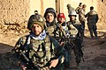 Afghan National Army special operations forces with the 6th Special Operations Kandak head out on patrol to clear what is believed to be a Taliban commander's house during an operation in the Sayed Abad district 131117-A-CL980-026.jpg