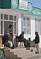 Afghan Uniform Police officers talk with a resident outside the police station near the Sayed Abad district center in Wardak province, Afghanistan, Feb 120213-A-BZ540-025.jpg