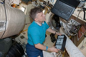 "Andrei Borisenko - Inside the space station, Borisenko conducts the Russian experiment KPT-10 ""Kulonovskiy Kristall""."