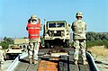Army STAFF Sergeant Kooker (right) and SPECIALIST Hart (left) of Delta 3-43, 11th Brigade Air Defense Artillery Fort Bliss, Texas, guides an M939A2 5 ton tactical truck safely off a - DPLA - b7352d01fbb5ef3eddb7efb075795de9.jpeg