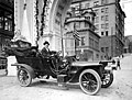 Automobile next to arch, Seattle, probably 1909 (TRANSPORT 27).jpg