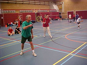 Badminton - A men's doubles match. The blue lines are those for the badminton court. The other coloured lines denote uses for other sports – such complexity being common in multi-use sports halls.