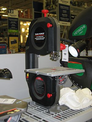 Photo of a bandsaw on display at a Lowes store.