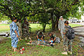Belize Defence Force combat medics treat a field casualty role player, center, while being observed by Belize Defence Force and U.S. Army observers and instructors, during a medical exchange, at at Price 100830-A-CL600-045.jpg