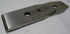 Plane (tool) - A bench plane iron with chipbreaker.