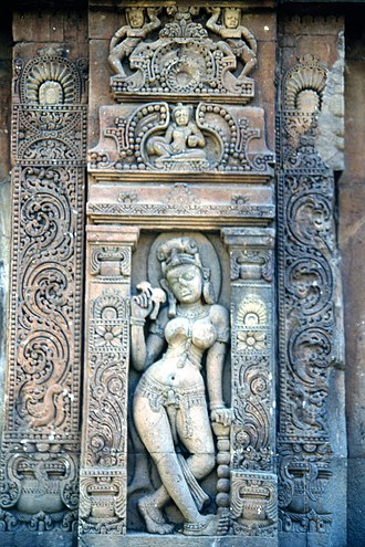 Apsara - A statue of an Apsara holding a bird in her hands from Baitala Deula.