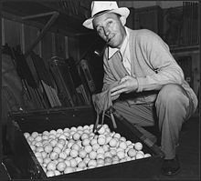 Bing Crosby (1942) with golf balls for the Scrap Rubber Drive during World War II.