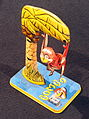 Bombo, tin toy monkey in tree, pic10.JPG