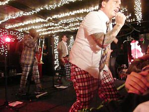 The Mighty Mighty Bosstones - The Bosstones in trademark plaid.
