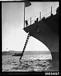 Bow view of United States Navy warship at anchor possibly during the 1925 goodwill tour (7552886086).jpg