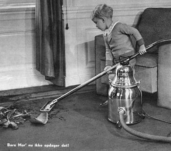 Boy vacuum cleaning