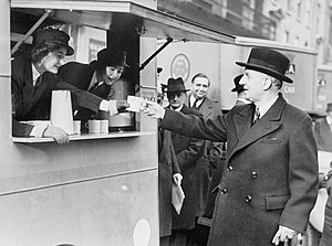 Woolton pie - The British Minister for Food between April 1940 and 11 November 1943, Lord Woolton, receiving a cup of tea from a mobile canteen.