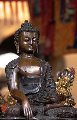 Photo of bronze statue of Buddha at the Sikkim Pavilion