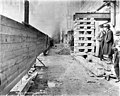 Building supports in alley next to the Smith Tower construction site, Seattle, Washington, January 2, 1912 (SEATTLE 4875).jpg