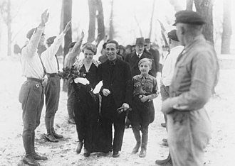 Magda Goebbels - Joseph and Magda's wedding day, with her son Harald Quandt in his Deutsches Jungvolk uniform. Adolf Hitler, their best man, can be seen in the background.