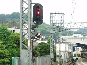 Japanese railway signals - Two diagonal white lights under a red light