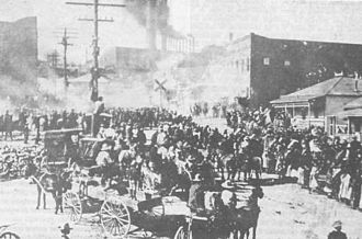 Cananea strike - The Cananea Riot of 1906, note the burning buildings in the background.