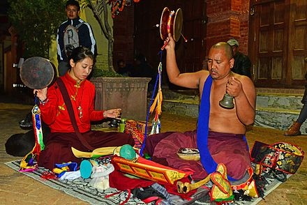 Tibetan Buddhists practicing Chod with various ritual implements, such as the Damaru drum, hand-bell, and Kangling (thighbone trumpet). Chod practitioners at Boudhanath stupa.jpg