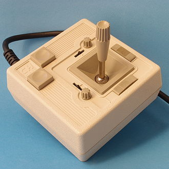 Joystick - CH Products Mach 2 analog joystick as used with many early home computer systems. The small knobs are for (mechanical) calibration, and the sliders engage the self-centering springs.