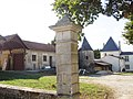 Chamouillac, château La Hoguette, courtyard buildings.jpg