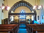 Chancel arch from nave in Llywel Church. Pulpit (left a.JPG