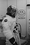Charlie Duke during a pressure integrity check during suit-up for launch.jpg