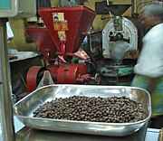 Coffee being ground at a coffee shop in Chennai, India