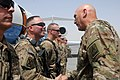 Chief of Staff of the U.S. Army Gen. Raymond T. Odierno, right, thanks Sgt. 1st. Class Danny Brown, a military policeman, for a job well done at Kandahar Airfield in Kandahar province, Afghanistan, Aug. 8 130807-Z-VM825-078.jpg