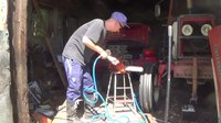 File:Cleaning a chainsaw with old air compressor.webm