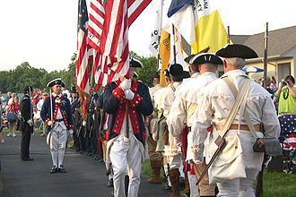 Sons of the American Revolution - Indiana Society SAR Color Guard appearing with the recreated 19th US Infantry at an outdoor 4 July concert with the Indianapolis Symphony Orchestra.