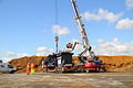 Crane lifting M2500 off lorry (7548512210).jpg
