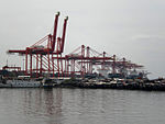 Cranes and Squatters at Manila North Harbor.JPG