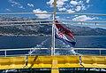 Croatian flag on a ferry to Sumartin, with Makarska on the background, Croatia (PPL1-Corrected) julesvernex2.jpg