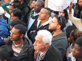 Anti-racism - Crowd rallying at a demonstration in Israel against manifestations of racism and discrimination.