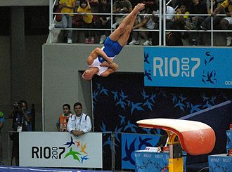 Artistic gymnastics - Diego Hypólito vaulting from a modern vaulting table during the 2007 Pan American Games.