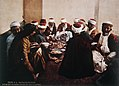 DRUSE RESIDENTS OF THE CARMEL FEAST ON A MEAL OF TRADITIONAL FOODS. COLOR PHOTO TAKEN IN THE LATE 19TH CENTURY BY FRENCH PHOTOGRAPHER, BONFILS. צילום צבע מסוף המאה ה19 של הצלם.jpg