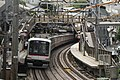 Daikan-yama Station of Tōkyū Tōyoko Line, and a train bound for Motomachi-Chūkagai via Minato-Mirai Line (2006-09-11 by dongpung @Pixabay 931162).jpg