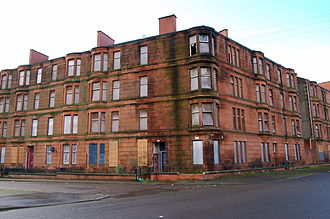 Dalmarnock - Victorian sandstone tenements in Ardenlea Street, Dalmarnock that were originally renovated as part of the GEAR (Glasgow East Area Renewal) scheme in the late1970s, have seen their residents systematically rehoused in recent years, thus being allowed to fall into a dilapidated state once more. They have now been totally demolished as part of the 2014 Commonwealth Games athletes village masterplan by RMJM.