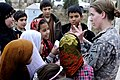 Defense.gov News Photo 110212-A-4526P-004 - U.S. Army 1st Lt. Rebecca Wagner counts with the Afghan children of the Red Crescent Society orphanage and school as the 4th Calvary Aviation.jpg