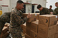 Defense.gov News Photo 110311-M-XX000-002 - U.S. Marines assigned to Combat Logistics Regiment 37 3rd Marine Logistics Group III Marine Expeditionary Force load food onto a cargo platform.jpg