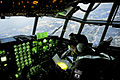 Defense.gov News Photo 110319-F-UI176-596 - U.S. Air Force Capt. Yuri Batten looks at a map while flying a C-130 Hercules filled with medical supplies over Yokota Japan on March 19 2011.jpg